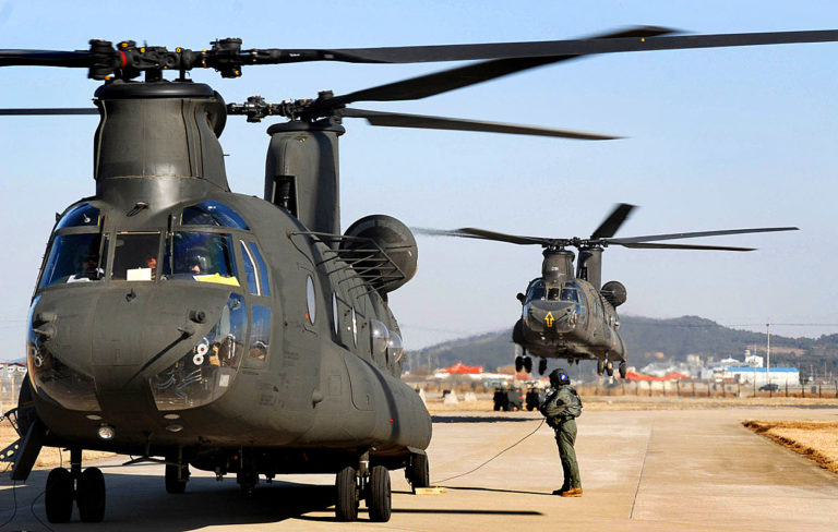 Two CH-47 Chinook helicopter's land March 1at Kunsan Air Base, South Korea. The Chinook's arrived from Camp Humphrey's, Bravo Company 4-2, as part of the Key Resolve/Foal Eagle Exercise, enhancing combat readiness and joint interoperability. (U.S. Air Force photo/Senior Airman Steven R. Doty)