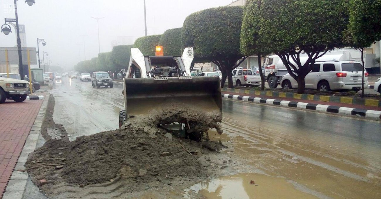 Saudi authorities begin to clean up after rains cause flooding.