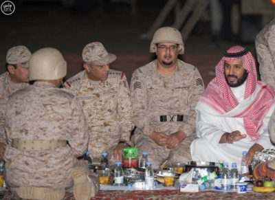 Crown Prince and Minister of Defense Mohammed bin Salman dines with Saudi security forces.