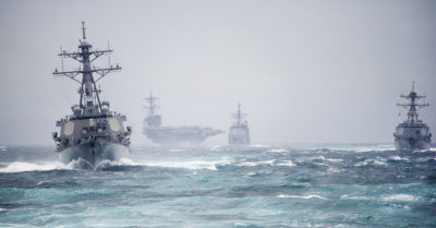 The guided missile destroyer USS Arleigh Burke (DDG 51), foreground left, leads the guided missile destroyer USS Truxtun (DDG 103), right, the guided missile cruiser USS Leyte Gulf (CG 55), center, and the aircraft carrier USS George H.W. Bush (CVN 77) during a strait transit exercise in the Atlantic Ocean Dec. 10, 2013. The ships were part of the George H.W. Bush Carrier Strike Group and were underway participating in a composite training unit exercise in preparation for a scheduled deployment. (DoD photo by Mass Communication Specialist 2nd Class Justin Wolpert, U.S. Navy/Released)