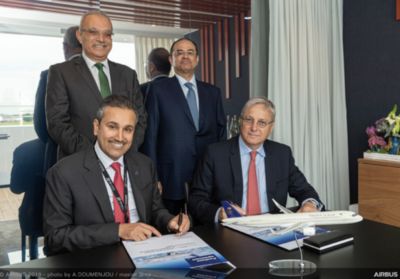 Representatives from Saudia and Airbus sign the agreement at the Paris Airshow.